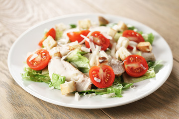caesar salad with red cherry tomatoes, shallow focus