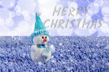 Toy Snowman with hat and scarf. Falling snow