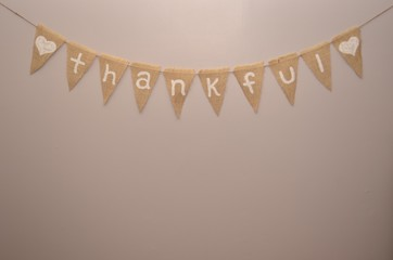 Thankful burlap sign on light beige background