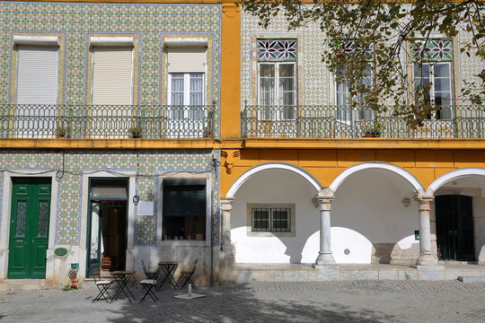 BEJA, PORTUGAL: Typical colorful facades in the old town with arcades