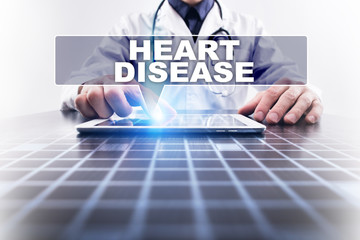 Medical doctor working with modern computer and selecting heart disease. Medical concept.