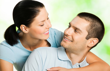 happy smiling amorous couple, outdoors