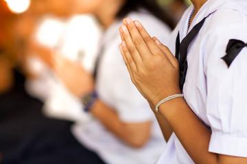 Thai student girl was begging monks.