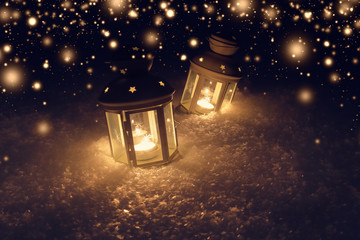 Christmas night background with lights. Lights with candles at night.