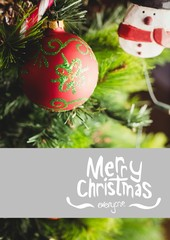 Composite image of merry christmas against christmas decoration