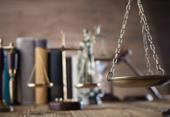 Mallet, legal code and statue of justice. Law concept, studio shots