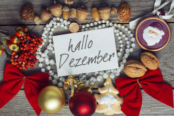 hello december greeting card text in German. frame of Winter and Christmas decor Poster with sunlight filter and toned grunge image