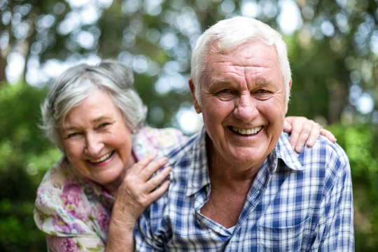 Portrait of senior couple laughing in back yard
