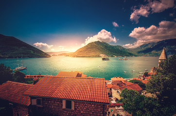 Harbor and ancient buildings in sunny day at Boka Kotor bay (Boka Kotorska), Montenegro, Europe.