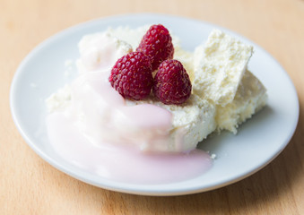 Cottage cheese in plate with berries