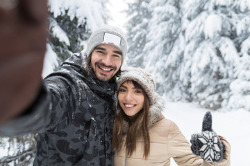 Man Taking Selfie Photo Young Romantic Couple Smile Snow Forest Outdoor Winter Pine Woods