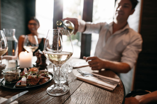 Young people having wine at restaurant
