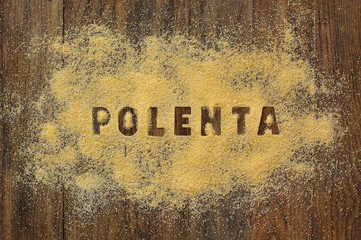 Wall Mural - Gluten free flour polenta with text on brown wooden background