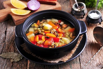 Fish soup with wild mussels, potatoes, carrots, tomatoes, pepper and dill.