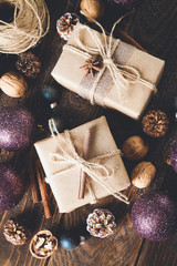 Festive christmas boxes with gifts, natural decorations and ball