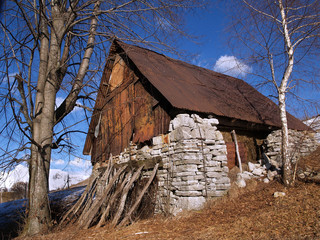 Wall Mural - Rustic old Alpine hay shed in Slovenia