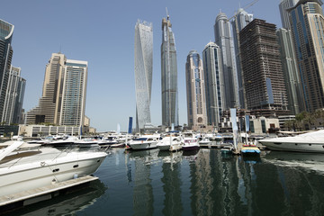 Architecture theme. Dubai, marina bay at noon. Luxurious travel and living.. Business and finance concept. Futuristic architecture. Luxury apartments. High value properties.