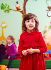 portrait of happy girl with disability at rehabilitation center for kids with special needs