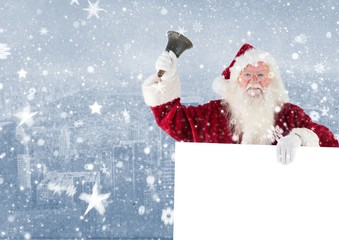 Santa claus holding a blank placard and bell