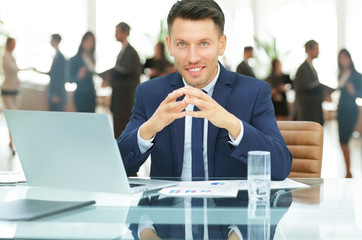company representative at the Desk on office background