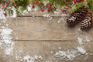 Christmas background with decorations and gift boxes on wooden b