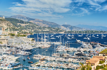 World Fair MYS Monaco Yacht Show, Port Hercules, luxury megayachts, many shuttles, taxi boat, presentations, Journalists, boat traffic, Azur water, aerial view, cityscape, mountains on background