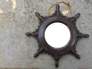 Steering boat picture frame on concrete wall