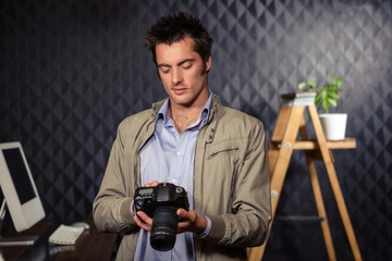 Creative businessman looking at picture on camera