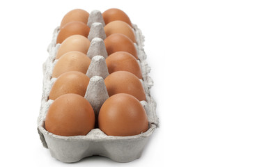 Dozen eggs isolated on a white background