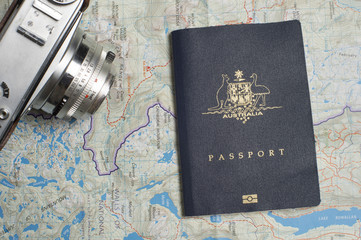 Close up of an Australian passport with map and retro camera