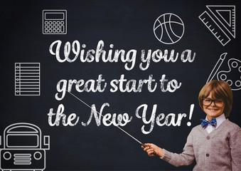 Smiling boy pointing at blackboard with new year greeting quotes