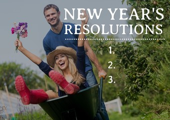New year resolutions against couple enjoying with wheel barrow