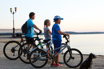Biker family silhouette. Happy family - father with two kids on