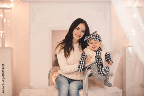 Smiling Young Mother Holding Her Little Baby Girl Under 1 Year Old