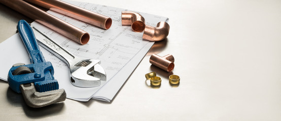 Plumbers Tools and Plumbing Materials Banner with Copy Space