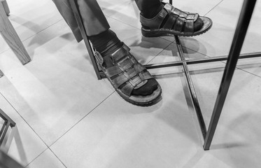 Relax concept, Businessman wearing sandals in the coffee shop. Black and White design.