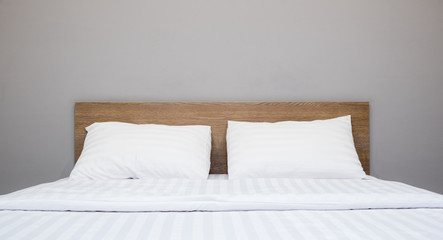white bedding and pillow in hotel room