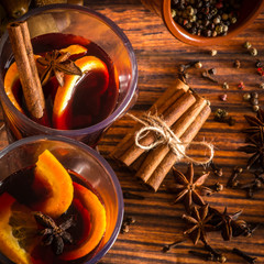 Christmas hot mulled wine with cinnamon, cardamom, anise and ora