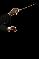Orchestra conductor music hands isolated