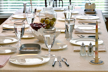 Table setting with antique cutlery ready for a formal gathering