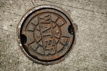 A water main manhole cover.