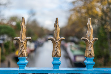 Lily shaped wrought iron fence on a bridge on the Regent's Canal