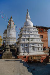Medieval buildings and structures surrounding Swayambhunath stupa in the temple complex. Kathmandu, Nepal