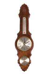 Vintage wooden wall clock with a barometer on a white background