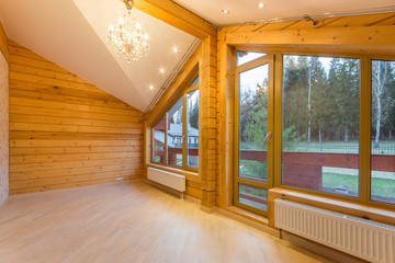 Large empty room in a new wooden house
