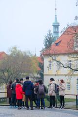 Prague, Czechia - November, 21, 2016: tourists on an excursion in Prague, Czechia
