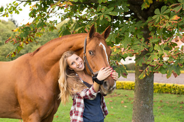 Young beautiful woman with a horse