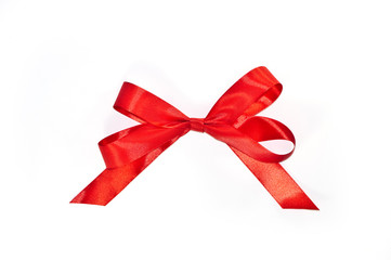Red bow from ribbon with tails isolated