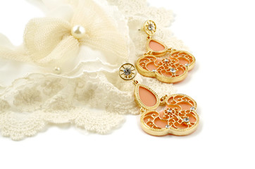 Vintage cream colored lace collar and earrings on white background