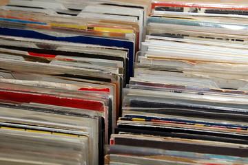 """Vinyl 7"""" single 45 rpm records for sale at a retro record fair"""